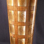 Steve Sinner, Class of '60 - Faded Memories, 2002, walnut wood turned vessel, silver leaf, ink, negative images, 23 1/4 x 8 1/8 x 8 1/8 inches, Collection of the Dubuque Museum of Art. Purchase award from the 2003/04 Tri-State Tri-Annual Juried Invitational.