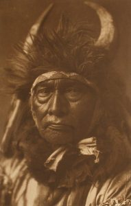 Edward S. Curtis, Bull Chief – Apsaroke, plate 128, 1908, photogravure on Dutch Van Gelder paper, 15 3/4x10 1/4 inches, Gift of the Dubuque Cultural Preservation Committee, an Iowa general partnership consisting of Dr. Darryl K. Mozena, Jeffrey P. Mozena, Mark Falb, Timothy J. Conlon, and Dr. Randall Lengeling, 2009.128